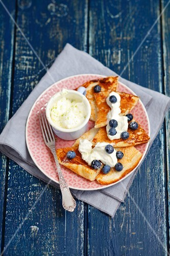 A sweet omelette with mascarpone and lime cream and blueberries