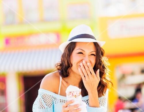 An Oriental woman eating ice cream