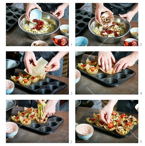 Pasta nests with tomatoes being made in a muffin tin