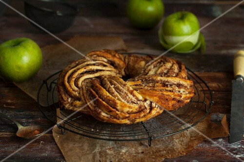 Apple and cinnamon wreath on a wire rack