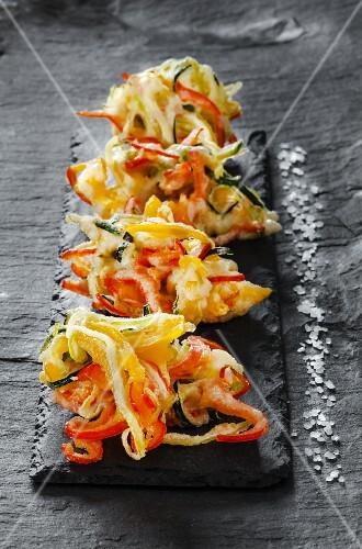 Fried vegetable strips in tempura batter