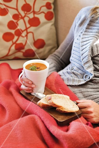 Tomato and pepper soup with beans and pesto