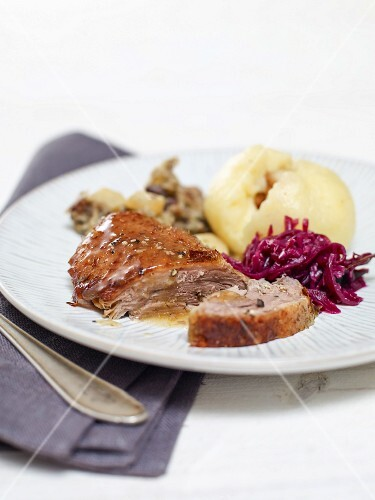 Goose with a chestnut stuffing served with red cabbage and dumplings