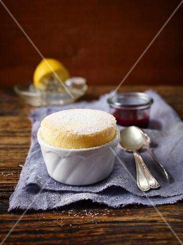 Lemon soufflé with blackberry sauce