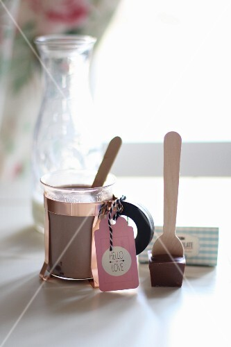 A glass of cocoa made from chocolate spoon