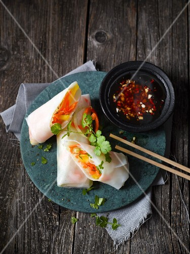 Vietnamese rolls filled with vegetables served with chilli sauce