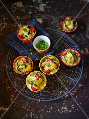 Carrot pasta nests with cocktail tomatoes