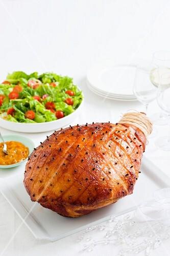 Glazed Christmas ham with a side salad