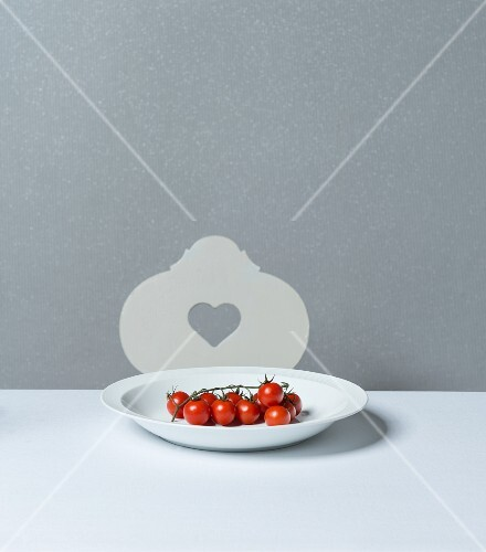 Vine tomatoes on a porcelain plate