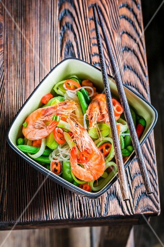 Prawns and vegetables served with rice noodles (Thailand)