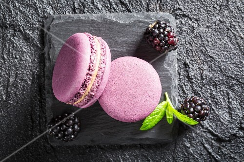 Blackberry macaroons on a black stone