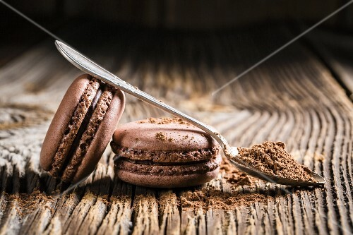 Chocolate macaroons on a wooden table