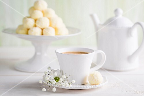 Coconut pralines served with coffee