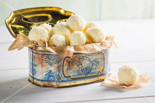 White coconut pralines in a metal tin
