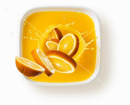 Oranges with a splash of juice