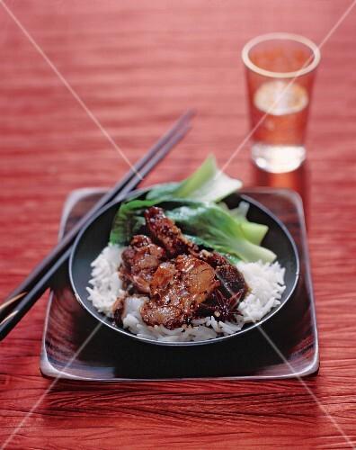 Spicy pork belly on jasmine rice, China