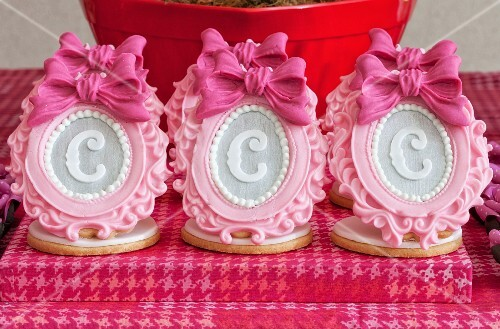 Elaborate sugar decorations with letters on shortbread biscuits