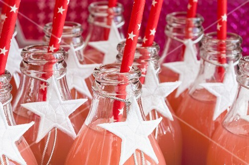 Fruit juice in glass bottles decorated with white stars