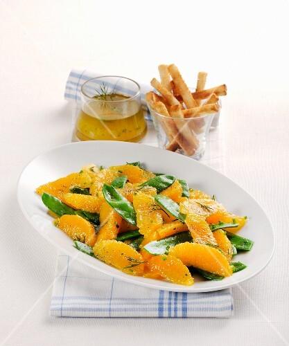 Orange and mange tout salad with breadsticks
