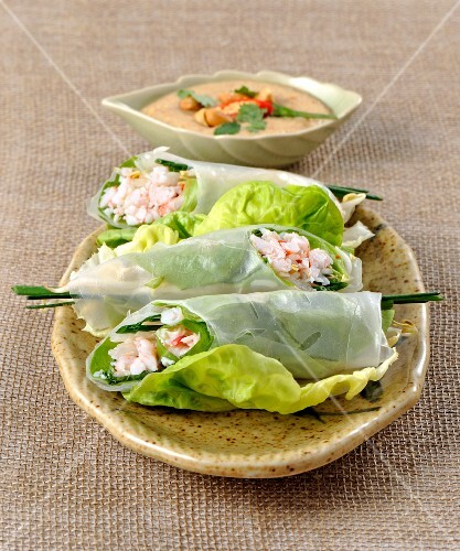 Rice paper rolls filled with prawns on lettuce leaves