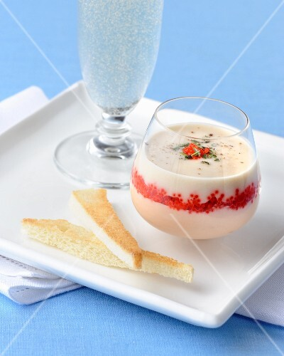 Spicy mousse with red caviar served with Prosecco