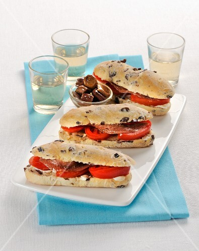 Olive rolls with tomatoes and anchovies