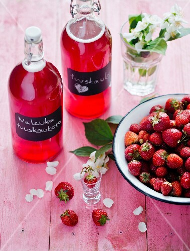 Homemade strawberry liqueur and fresh strawberries