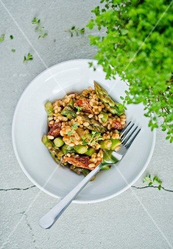 Pearl barley with green asparagus and dried tomatoes
