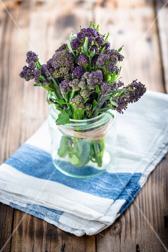 A bundle of purple sprouting broccoli in a jar