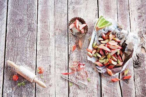 Sliced fresh rhubarb on a piece of newspaper
