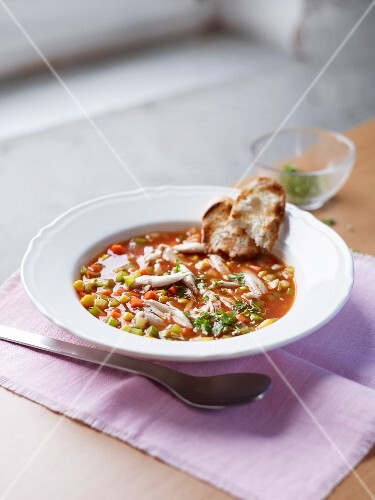 Chicken stew with sweetcorn served with grilled bread
