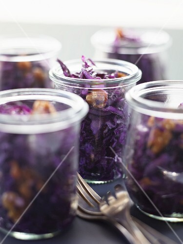 Red cabbage salad with walnuts in jars