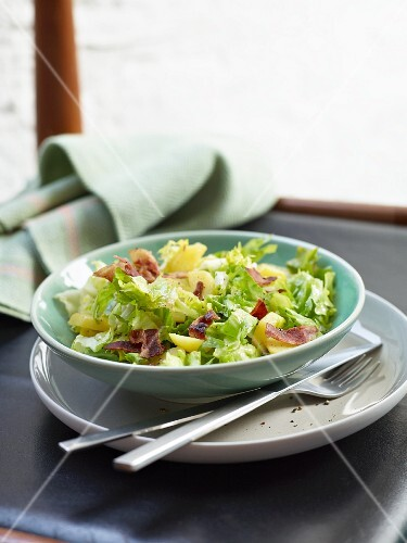 A rustic chicory salad with bacon