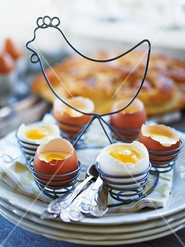 White chocolate mousse with peach slices in eggshells