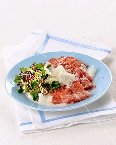 Tagliata di cotechino (raw sausage meat with shaved Parmesan, Italy)