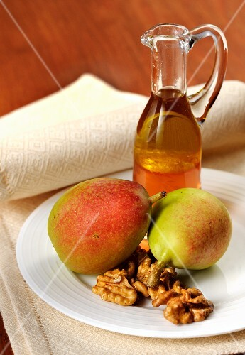 An arrangement of pears, nuts and liqueur
