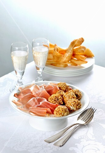 Parma ham and Robiola truffles served with Prosecco