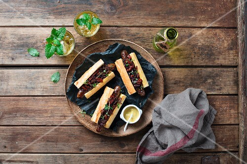 Hot dogs with caramelised onions and mustard