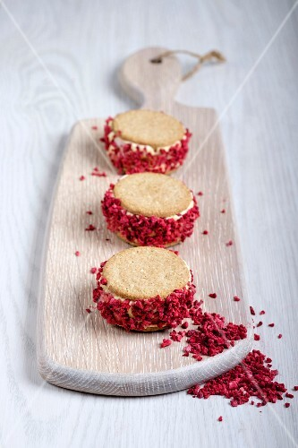 Strawberry shortcake ice cream sandwiches on a chopping board