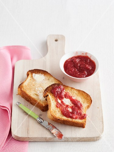 Strawberry jam and butter on toast