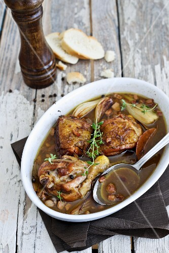 Braised chicken with balsamic vinegar, onions, bacon and thyme