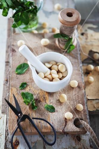 Macadamia nuts in a mortar