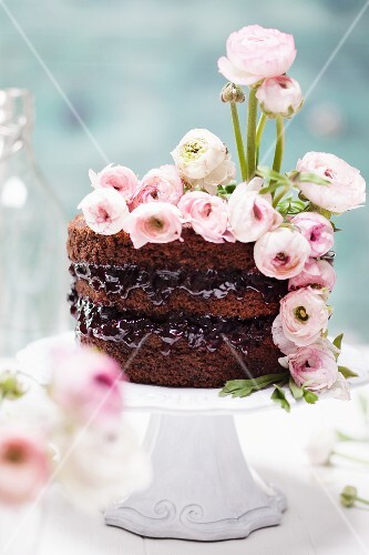 A spring chocolate cake made with beetroot decorated with buttercups