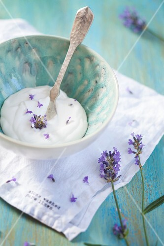 Coconut cream with lavender flowers in a ceramic bowl