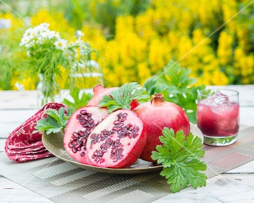Pomegranates on a garden table