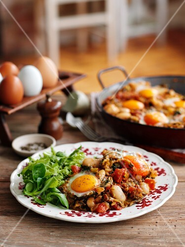 Ratatouille with courgettes, butter beans and fried egg