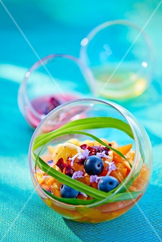 Fruit salad in a glass ball