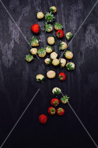 Strawberries on a black surface