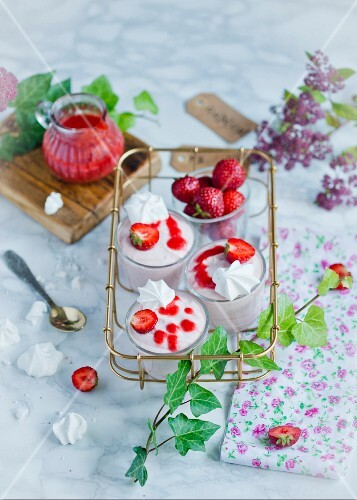 Strawberry mousse with meringues in an old-fashioned metal stand