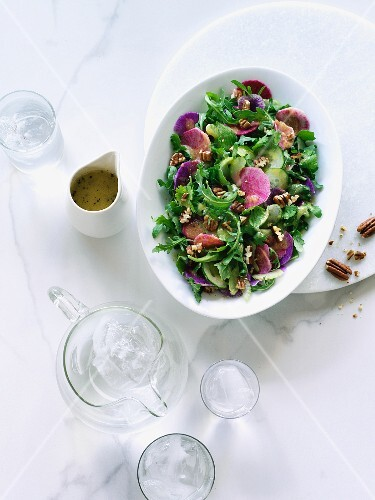 Fresh rocket salad with pecan nuts and watermelon radishes